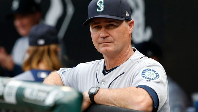 Seattle Mariners manager Scott Servais looks to the field before a baseball game against the Chicago White Sox, Saturday, July 15, 2017, in Chicago. (AP Photo/Nam Y. Huh)