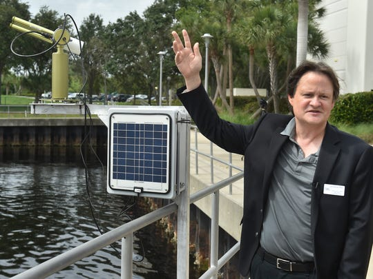Jim Sullivan, interim Executive Director of Harbor Branch Oceanographic Institute at Florida Atlantic University, introduces the SeaPRISM system, a device built by NASA, to help monitor for blue-green algae blooms in Lake Okeechobee, during a meeting on Wednesday, May 30, 2018, at the Harbor Branch campus in northern St. Lucie County. The system is scheduled to be deployed in the middle of Lake Okeechobee during the week of June 11.