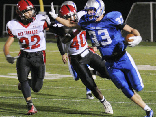 Cedar Crest's Evan Horn gets a step on McCaskey defenders last season. If Horn's allowed to turn the corner against Lebanon, it'll be trouble for the Cedars. (Ashley Walter -- For the Lebanon Daily News)