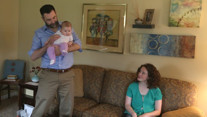 Mike Murphy of Rochester holds three-month-old daughter Frances, giving wife Annie Murphy a break after lunch.