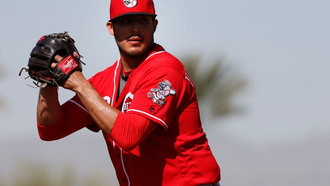 Cincinnati Reds pitcher Pedro Villarreal (62) gets set before delivering during live batting practice at Cincinnati Reds spring training, Saturday, Feb. 27, 2016, in Goodyear, Arizona.