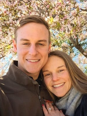 James Hoover and Tatiana Mirutenko are pictured in April 2016 among the cherry blossoms near the Washington Monument in Washington, D.C.