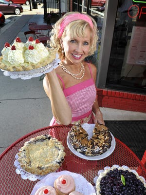Linda Hundt is the owner of Sweetiel-licious Bakery Cafe in DeWitt. Here she shows some of her award-winning baked goods.