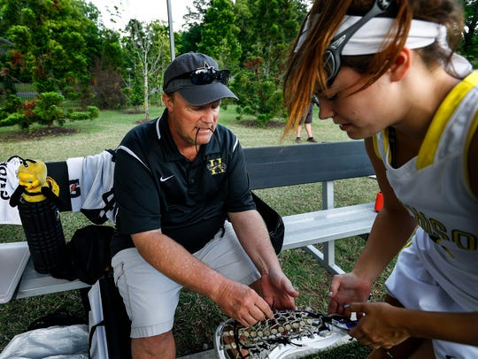Hutchison lacrosse coach Dave Gearhardt helps with
