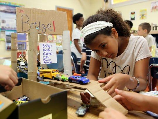 Fourth-grader Nicolle palacios, 10, creates a ramp