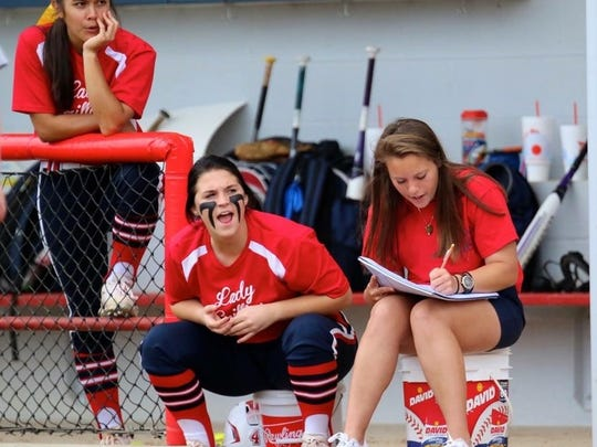 Lauren Davlin, right, keeps tabs on her North DeSoto