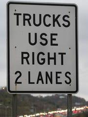 A sign at the foot of the cut in the hill on I-75,