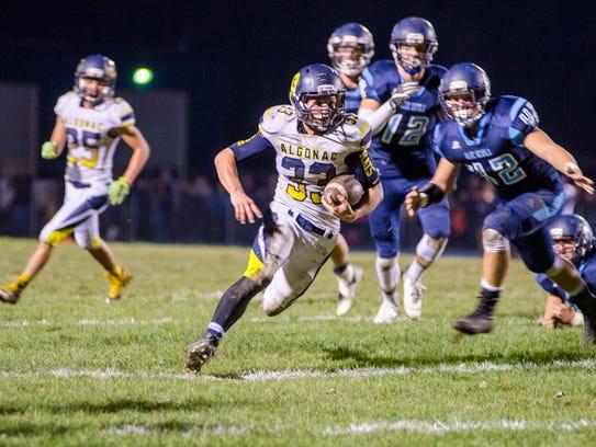 Algonac High School running back Jack Jewell runs the
