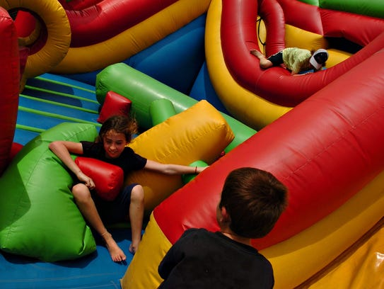 The Koomba Combo bounce house is one of the attractions