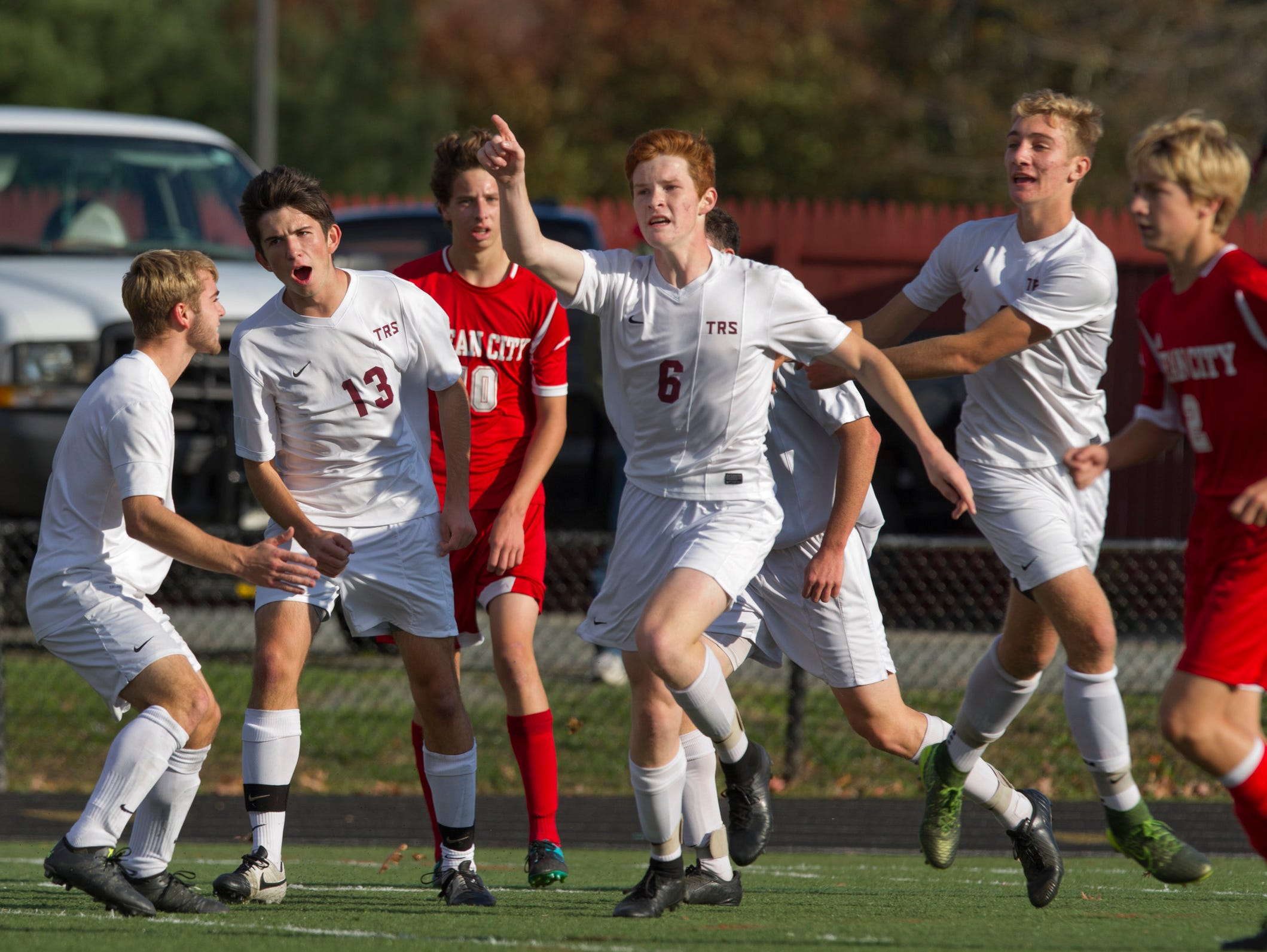 Toms River South's Cameron Geerinck salutes the audience as he celebrates with teammates one of his two first half goals. Toms River South vs Ocean City in NJSIAA Boys Group Soccer Final on November 13, 2015