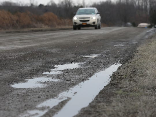 Residents of Milewood Road in Chili are fighting the town to make needed repairs to the pot-hole covered .8-mile stretch of dirt road.