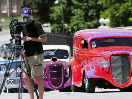 Street rods drive out the West Market Street exit at the York Expo Center before the 2014 parade.