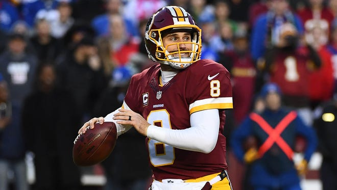 Washington Redskins quarterback Kirk Cousins (8) drops back to pass against the New York Giants during the first half at FedEx Field.