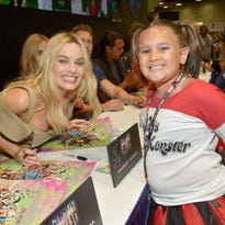 Nerds have descended upon San Diego for Comic-Con International, the annual gathering of entertainment enthusiasts. 'Suicide Squad' star Margot Robbie (left) poses with a young Harley Quinn cosplayer at DC's Comic-Con booth.