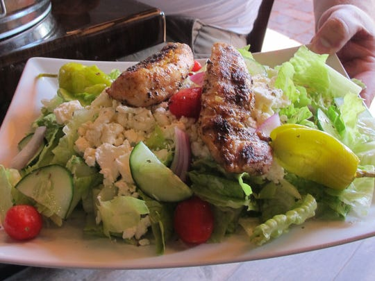Grilled chicken added to a Greek salad at Jimmy's P's Burgers & More, which recently opened in North Naples.