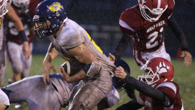 Jared Smith, left, will try to help Pewamo-Westphalia capture a sixth straight district title this weekend.