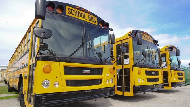 In this file photo, school buses sit in the Department of Public Works compound in Tamuning.