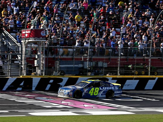 Jimmie Johnson takes the checkkered flag to win the