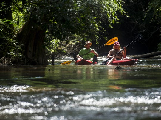 Skip Lobmiller and Tracey Burton kayak down the Autauga Creek Canoe Trail.
