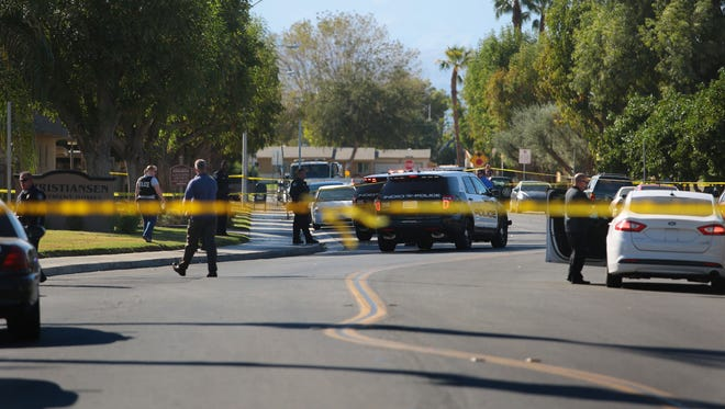 Police investigate a shooting on Shadow Palm Ave. Wednesday in Indio near the intersection with Monroe St.