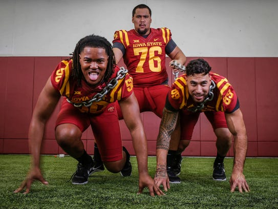 Iowa State defensive ends Eyioma Uwazurike, left, and