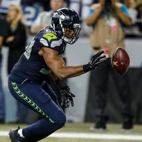Seahawks S Kam Chancellor initiates the controversial play by stripping Lions WR Calvin Johnson