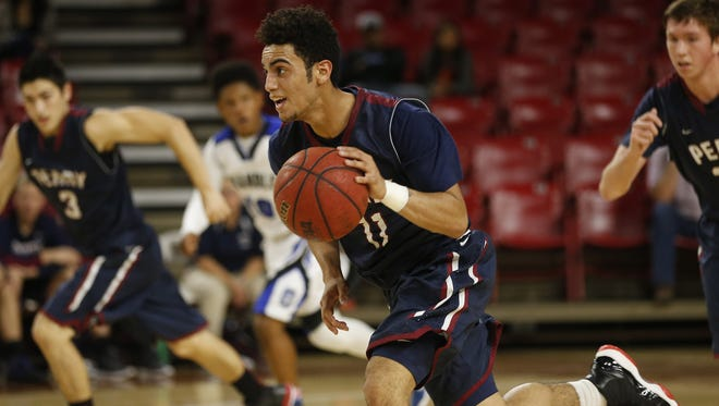 Perry High's Markus Howard (11) runs the fast break against Chandler High during the MLK Basketball Classic at Wells Fargo Arena January 19, 2015.