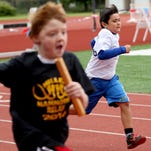 Second grade boys race during the 42nd annual Country Kids Relays at McCulloch Stadium at Bush's Pasture Park in Salem on Saturday, May 21, 2016.