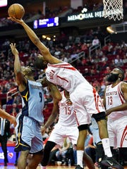 Houston Rockets forward Trevor Ariza (1) grabs a rebound over Memphis Grizzlies guard Tony Allen (9) in the first half of an NBA basketball game, Saturday, March 4, 2017, in Houston.