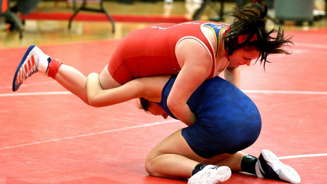 McPherson's Holli Giddings defeated Nickerson's Lauren Kinsey in the first place match in the 155 weight class Saturday at the McPherson Wrestling Invitational. To see more photos go to www.hutchnews.com/photos