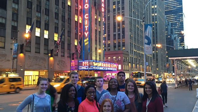 Members of Greer High School's Virtual Enterprise team pose on the streets of New York City, where they became one of only three schools to score Gold Level honors in two divisions of a national competition.