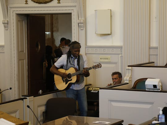 Musicians London McDaniels and Johnny Russo play upbeat music as people walk into the main courtroom for the naturalization ceremony on Wednesday, Nov. 2.