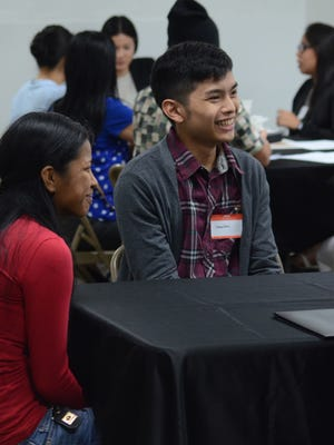 Forever 21 job applicant Jonathan Lujan, right, smiles while listening to a company representative during a group interview at Guam Premier Outlets in February. Private sector jobs increased by 2.4 percent between March 2014 and March 2015.