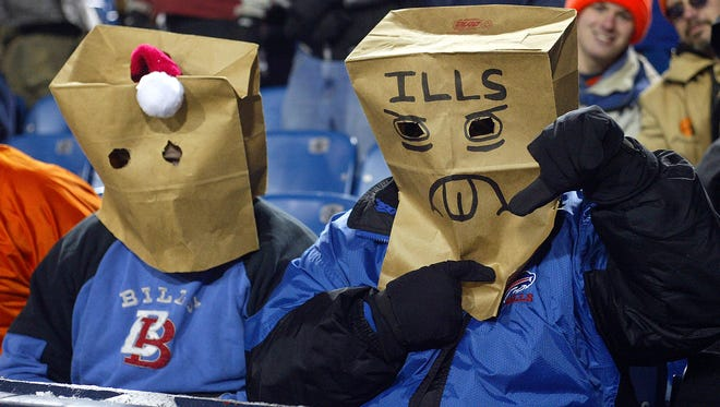 Fans of the Buffalo Bills sit with paper bags over their heads during a loss to the Denver Broncos on Dec.17, 2005 at Ralph Wilson Stadium.