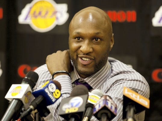 Los Angeles Lakers' Lamar Odom speaks to the media during a news conference after the Lakers signed Odom to a multi-year contract. Odom spent most of his 14-year NBA career in Los Angeles with the Lakers and Clippers, becoming a fan favorite before he sought even more fame with the Kardashians. Odom, who was embraced by teammates and television fans alike for his Everyman approach to fame, was found face-down and alone Tuesday after spending four days at the Love Ranch, a legal Nevada brothel.