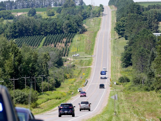 Police and public travel along Highway 64 at the edge