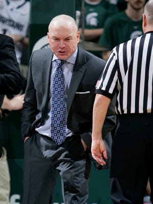 Penn State coach Patrick Chambers yells at an official before being charged with a technical foul during the second half of his team's NCAA college basketball game against Michigan State, Wednesday, Jan. 21, 2015, in East Lansing, Mich. Michigan State won 66-60.