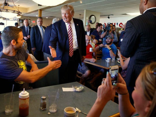Republican presidential candidate Donald Trump shakes hands during a visit to Goody's Restaurant, Monday, Sept. 5, 2016, in Brook Park, Ohio.