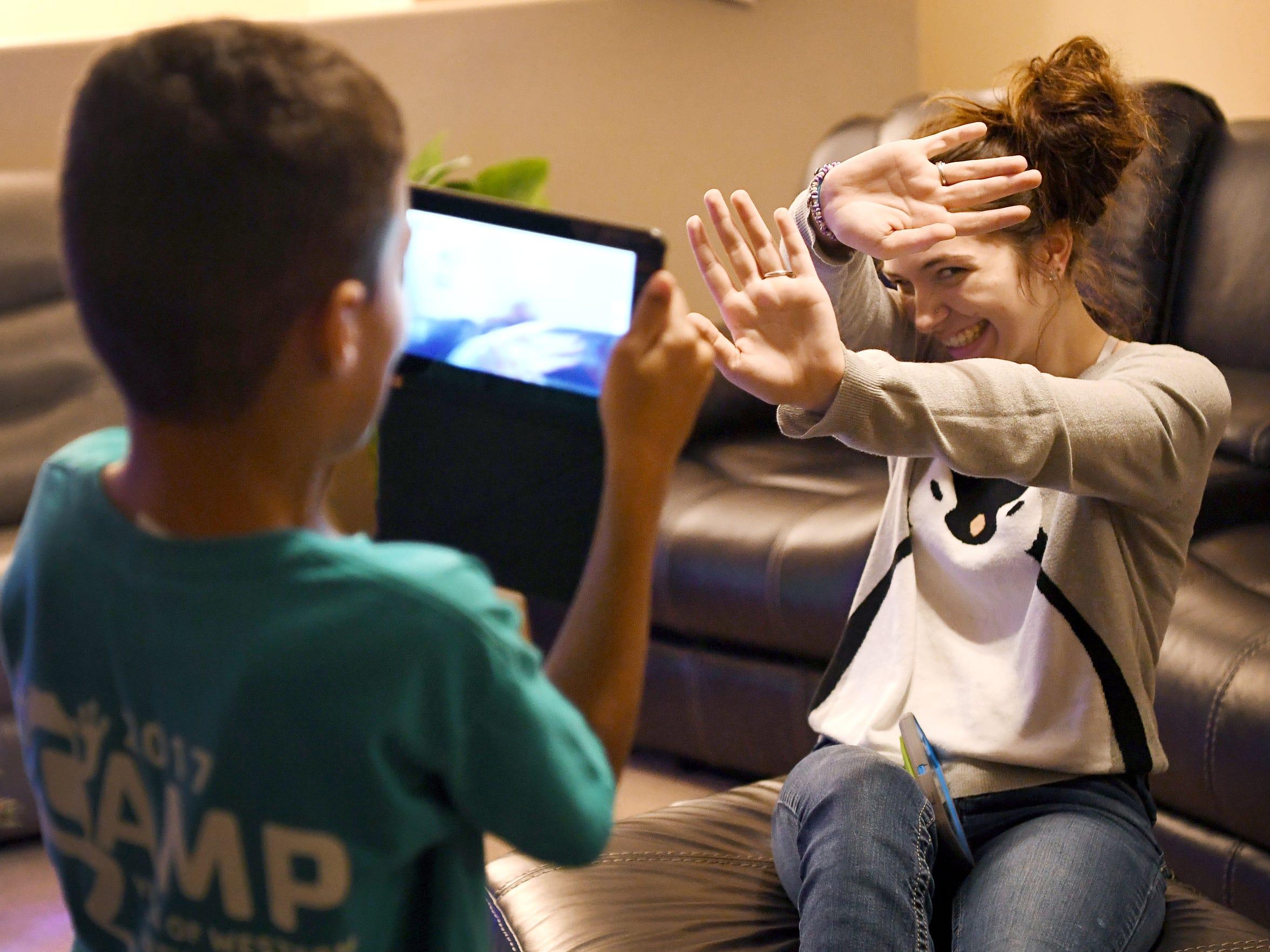 Megan Wyatt, 17, laughs as she blocks Emanie, her foster