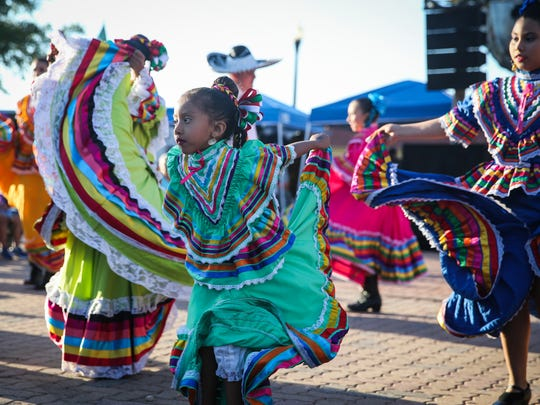 Ballet Folklorico dancers perform during the Cinco