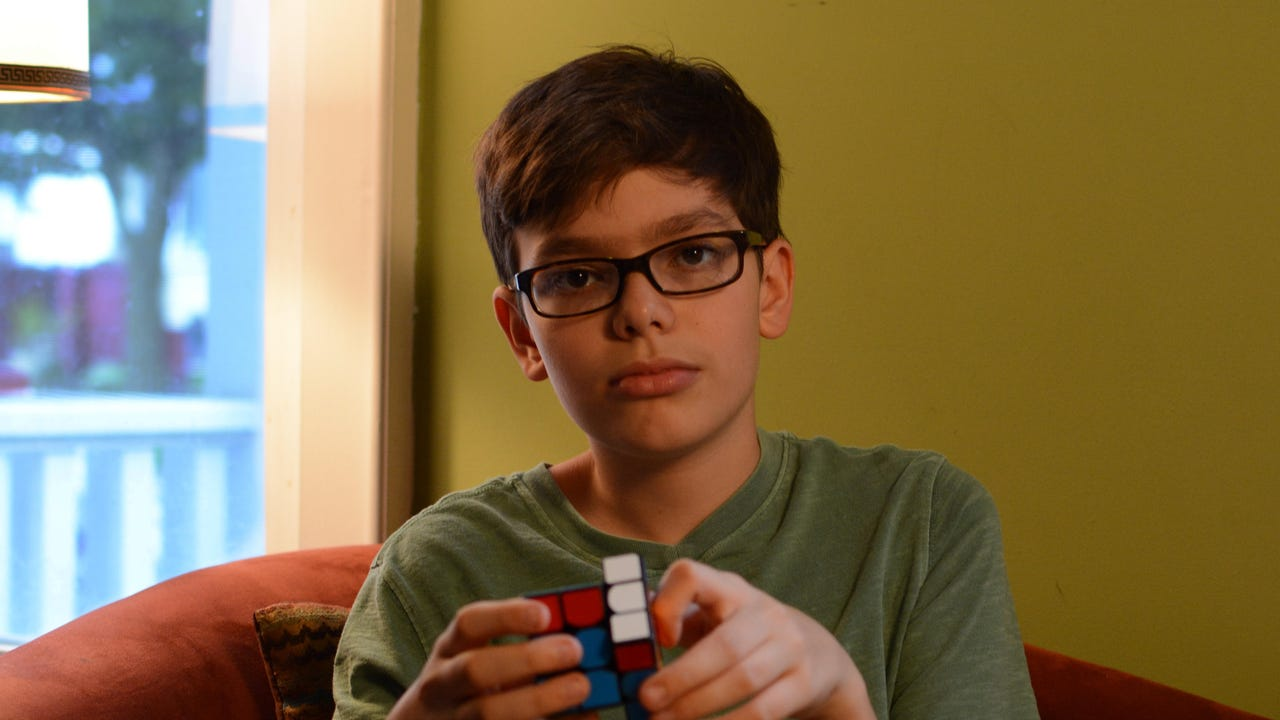 Levi Edler, 13, shows off his skills solving the Rubik's Cube. For the second straight year, the Milwaukee boy will participate in a national Rubik's Cube competition this summer.