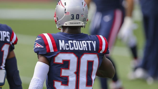 New England Patriots cornerback Jason McCourty (30) wears a social justice decal on his helmet prior to an NFL football game against the Las Vegas Raiders, Sunday, Sept. 27, 2020, in Foxborough, Mass.