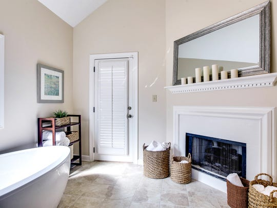 The master suite is on the main floor and has a fantastic bath, complete with a fireplace.