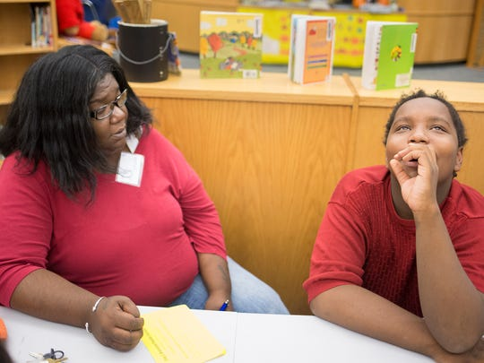 KaShanda Jones-Wright and her son, Sha-Kir, 12, work