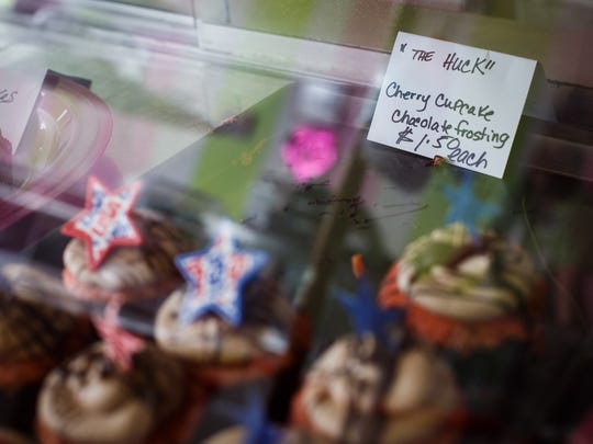"""""""The Huck"""" a cupcake created by Stacy Grams of Newton sits in her store, Stacy's Sweetstuff, in Newton at 11:30 a.m. Tuesday, Jan. 26, 2016. Grams is Huckabee's county chair person and made the cupcake in his honor. When his wife tried to bring him one on her last stop at the bakery it was taken at the airport by security. Grams made sure to deliver one to him this time as he stopped at Moo's BBQ on Tuesday."""