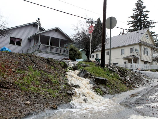 Water flows through Dunsmuir on Thursday as melting snow and heavy rain moved through the area.