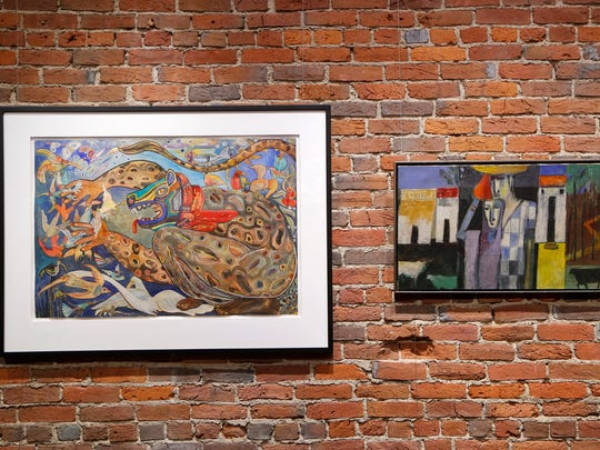 "A mixed media drawing by artist Francisco Oñate titled ""Entre Aves (Among the Birds)"", left, paired next to an oil painting by artist Arun Bose titled ""Village"" Tuesday, March 7, 2017, at the Fountain Gallery in downtown Lafayette. Both pieces are part of the exhibit Color Expressions March 7-April 22 at Fountain Gallery."