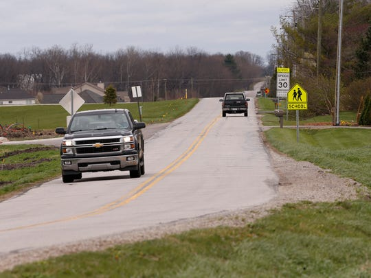 Facing east on County Road 600 N just west of Battle Ground Middle School Thursday, April 6, 2017, near West Lafayette  The Tippecanoe County Area Plan Commission is updating its 5 year plan, which makes recommendations for shaping land use, infrastructure and transportation across greater Lafayette and Tippecanoe County. The plan includes the conversion of some rural roads to urban roads, which is a technical designation but also reflects the area's growth outward into the county.