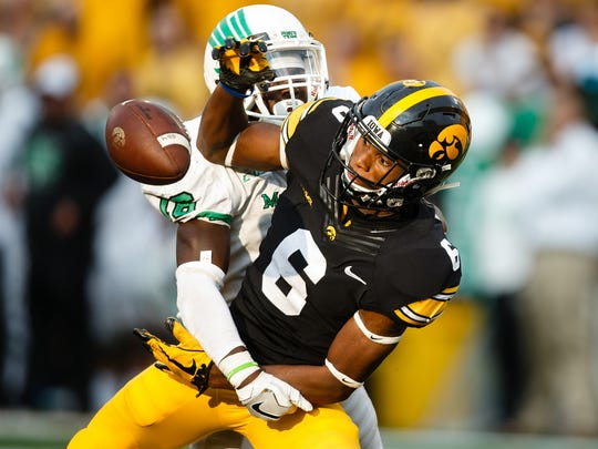 Iowa's Ihmir Smith-Marsette (6) can't come up with a pass during their football game  against North Texas at Kinnick Stadium on Saturday, Sept. 16, 2017, in Iowa City. Iowa would go on to win 31-14.