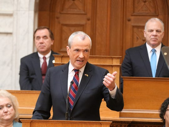 Assembly Speaker Craig Coughlin, left, and Senate President Stephen Sweeney, right, listen as Gov. Phil Murphy delivers his first budget address on March 13, 2018, in the Assembly chamber.